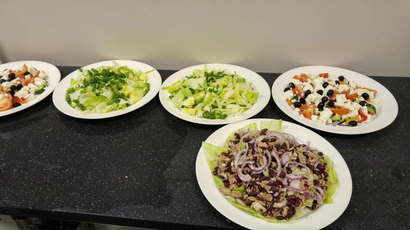 Vibrant salads created by chef Martyn Wood from donations to The Real Junk Food Project Dewsbury